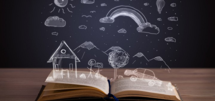Open book with hand drawn landscape